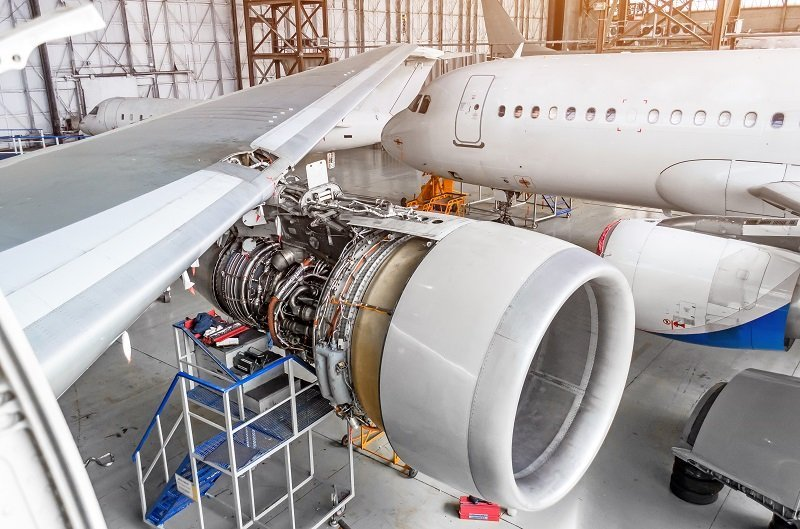 View Of The Wing And Engine Of The Aircraft Repair In The Hangar.